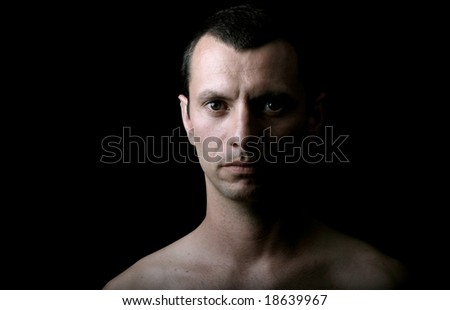 young man model on a black background - stock photo