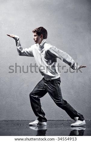 Young man modern dance. High contrast effect. - stock photo