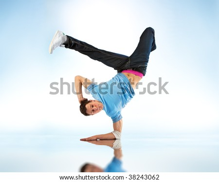 Young man modern dance. On soft white and blue background. - stock photo