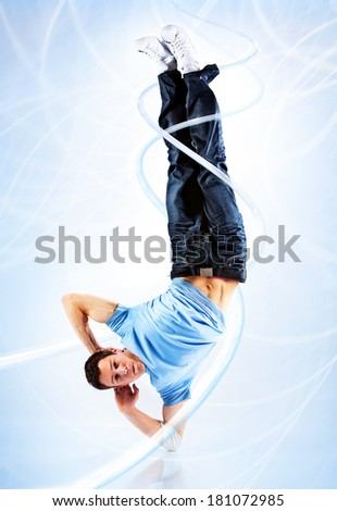 Young man modern dance. With light effects. - stock photo