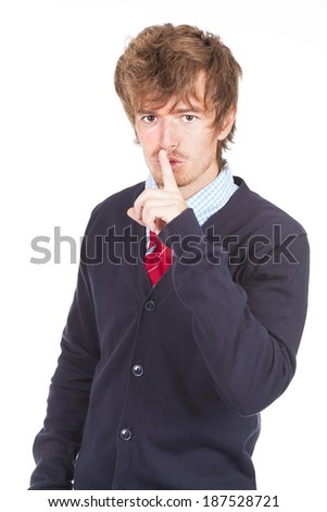 Young man mouth finger - stock photo
