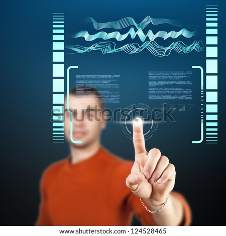 Young man navigating holographic virtual reality interface. - stock photo