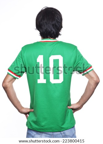 Young man of backs with green jersey on white background. - stock photo