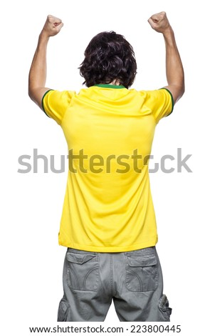 Young man of backs with yellow jersey on white background. - stock photo