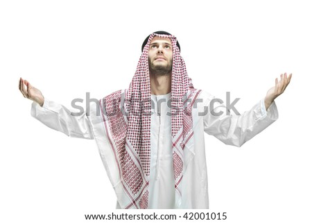 Young man of muslim religion praying isolated on white background