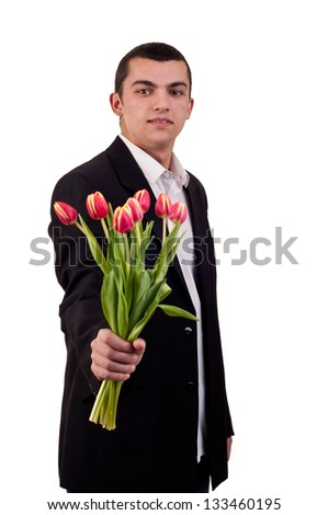 Young man offering tulip flowers - stock photo