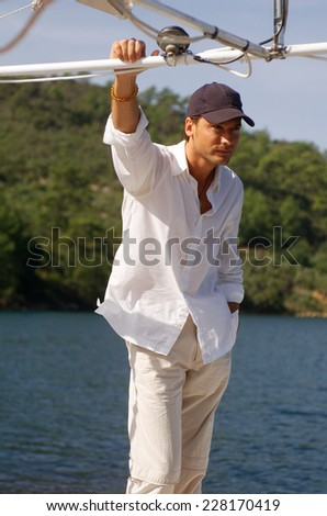 Young man on a boat, half - stock photo