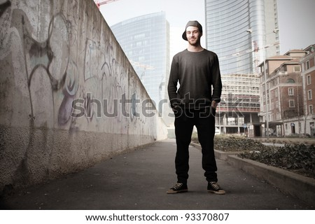 Young man on a city street - stock photo
