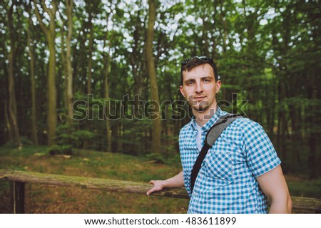 Young man on a walk in the forest.