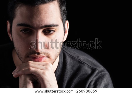 Young Man on Black Background - stock photo