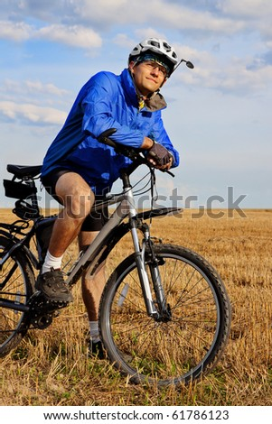 young man on mountain bike looking aside