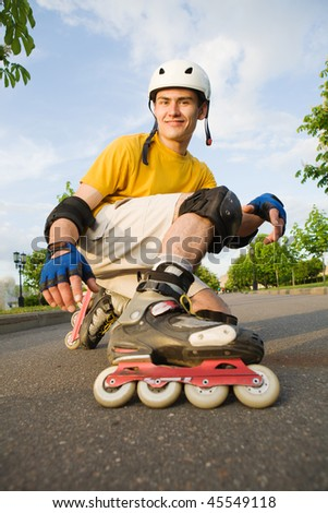 Young man on rollerblades at park