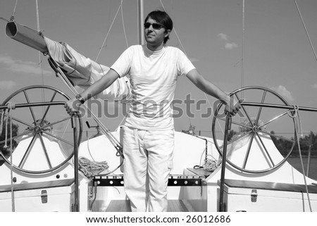 Young man on sailboat desk look. - stock photo
