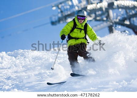 Young man on skis out of slopes. Off-piste skiing