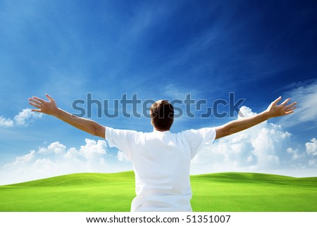 Young man on spring field - stock photo