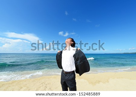 Young man on the beach enjoy sunlight