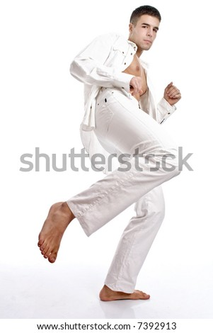 young man on the move with leg, legs are in focus and face motion blur - stock photo