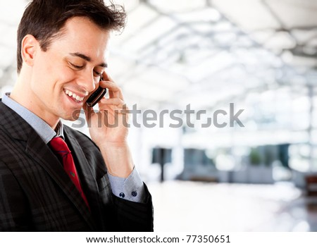 Young man on the phone at the airport saying goodbye to his partner while leaving for business - stock photo