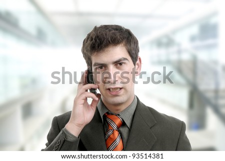 young man on the phone at the office