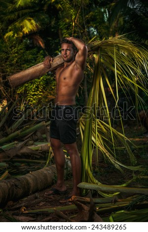Young man on vacations with a palm tree   - stock photo
