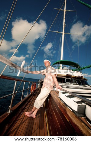 young man on yacht - stock photo