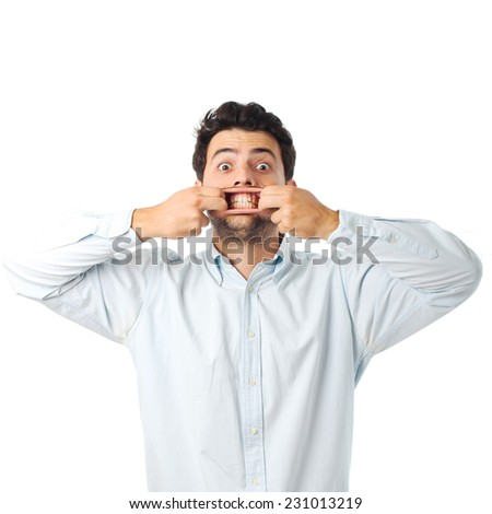 young man opening mouth with hands on a white background - stock photo