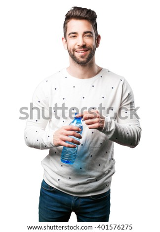 young man opening water bottle - stock photo