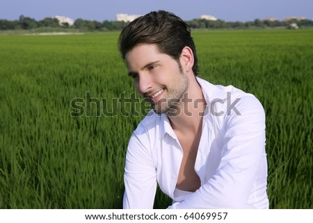Young man outdoor happy relaxed on green rice field meadow