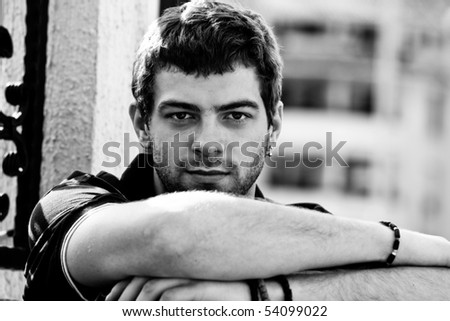 young man outdoor portrait, black and white
