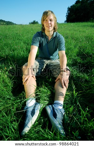 young man outdoors in summer - stock photo