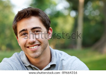 Young man outdoors portrait with copy space - stock photo