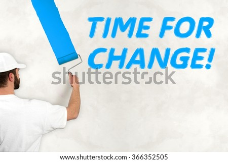 young man painting wall with blue color - stock photo