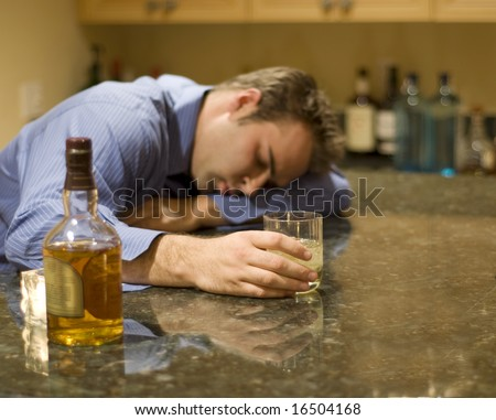 young man passed out from drinking alcohol - stock photo