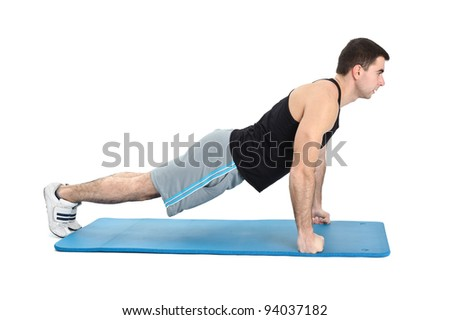 young man performing push-ups exercise on fists, on white background