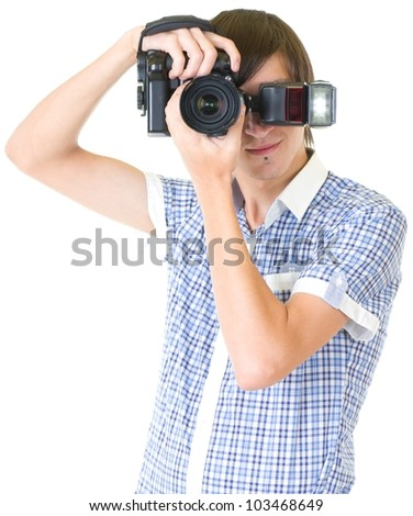 Young man photographer doing photos by digital camera - stock photo