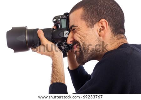 Young Man Photographer Taking Photos - stock photo