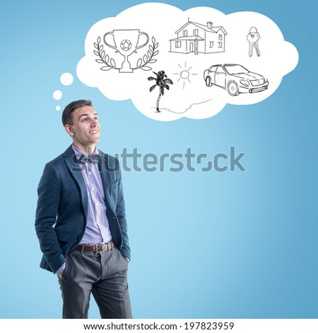 Young man planning his future and dreaming mortgage credit house car recreation vacation travel - stock photo