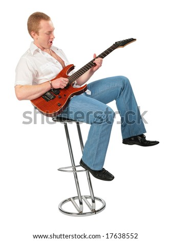 Young man play guitar on chair