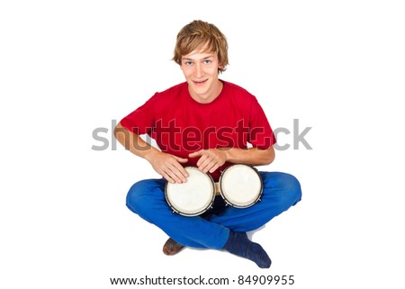 Young man playing bongos - isolated on white - stock photo