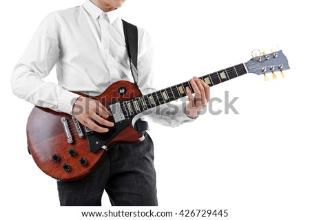 Young man playing electric guitar on white background