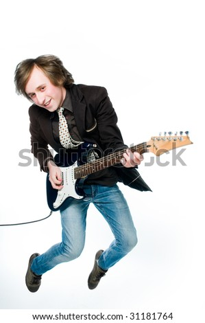 Young man playing electro guitar, motion blur - stock photo