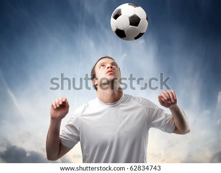 Young man playing football - stock photo