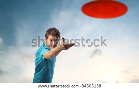 Young man playing Frisbee - stock photo