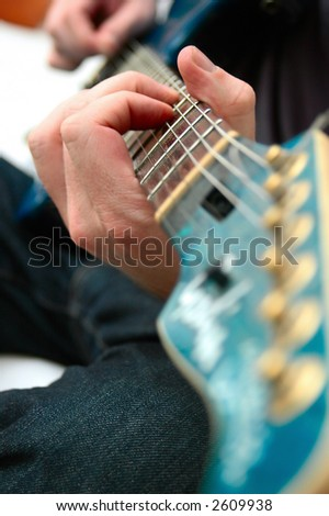 Young man playing guitar - shallow depth of field
