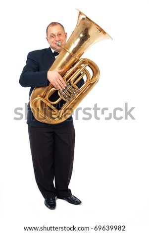 Young man playing his tuba