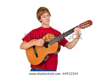 Young man playing on a guitar - isolated on white - stock photo