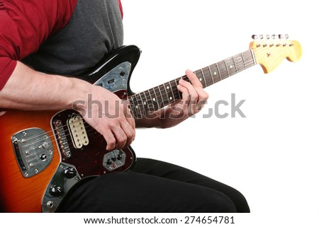 Young man playing on electric guitar isolated on white - stock photo
