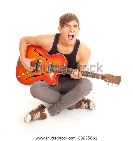 young man playing on orange electric guitar and singing - stock photo