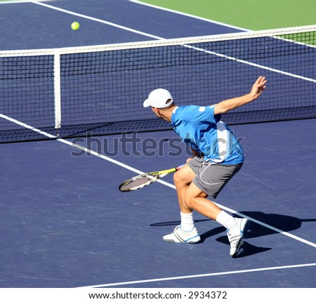 Young man playing professional tennis