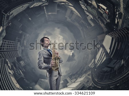 Young man playing saxophone on cityscape background